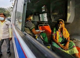 File photo of a woman being administered oxygen in an ambulance outside a hospital in Ahmedabad | Praveen Jain | ThePrint