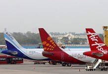 Aircraft stand at Terminal 3 of Indira Gandhi International Airport in New Delhi   Photographer: T. Narayan   Bloomberg