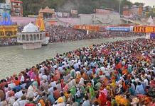 Devotees gather at Har Ki Pauri Ghat to offer prayers during Kumbh Mela in Haridwar on 11 April 2021 | PTI Photo