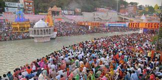 Devotees gather at Har Ki Pauri Ghat to offer prayers during Kumbh Mela in Haridwar on 11 April 2021 | PTI Photo
