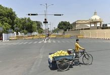 A fruit vendor during lockdown in Lucknow, on 24 April 2021 | PTI Photo