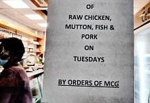 A Green Chick Chop outlet in Gurugram has put up a notice to announce the ban on sale of raw meat on Tuesdays. Photo by Shubhangi Misra. | ThePrint