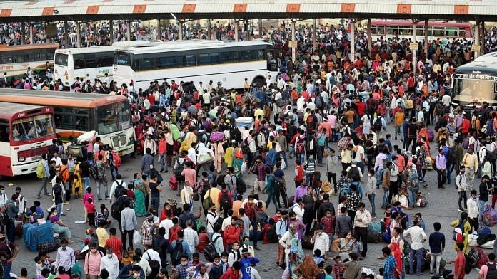 A view of the Anand Vihar bus terminal as migrants return to their states after the announcement of a week-long lockdown, in New Delhi on 19 April. | Photo: ANI