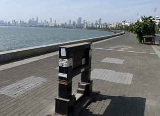 A view of deserted Marine Drive after curfew-like restrictions were imposed across Maharashtra, in Mumbai on 20 April.| Photo: ANI