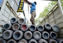 Workers load empty cylinders of medical oxygen in New Delhi, 21 April 2021   PTI Photo