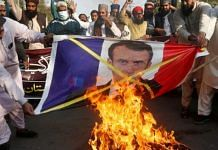 Tehreek-e-Labbaik Pakistan agitators burn a photo of French President Emmanuel Macron in protest against blasphemous caricatures published in France in 2020 | @SabahKashmiri | Twitter