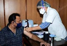 A person being vaccinated against Covid in Jaipur | Rohit Jain Paras | ThePrint