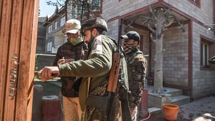 Police personnel examine the scene after the residence of BJP leader Anwar Ahmad Khan was attacked by alleged militants at Near Nowgam, in Srinagar, Thursday, April 1, 2021.   PTI
