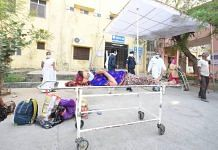 A patient lies on a stretcher as she waits for a bed at Bhilwara's MG hospital   Rohit Jain Paras   ThePrint