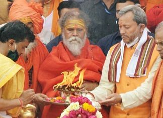 A file photo of Uttarakhand Chief Minister Tirath Singh Rawat (second from right) in Haridwar. | Photo: ANI