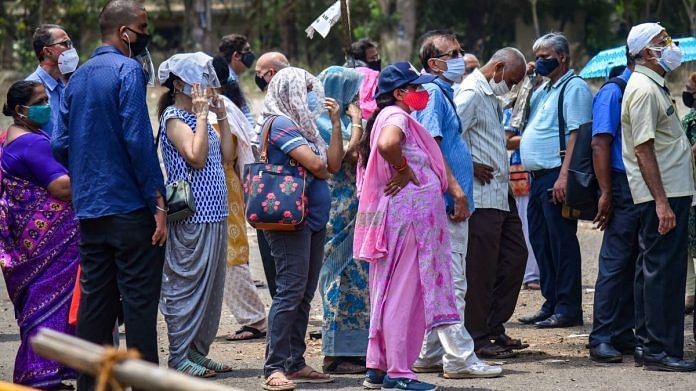 Representational Image | People wait in a queue to receive a dose of Covid-19 vaccine in Mumbai, on 26 April 2021 | PTI
