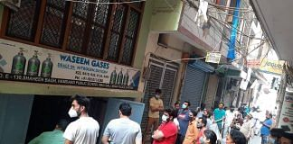 People waiting for oxygen outside Waseem Gases in Delhi's Shaheen Bagh | By special arrangement