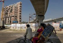 A rickshaw travels past an under construction elevated line for the Dhaka Mass Rapid Transit Co. metro in Diabari, Dhaka, Bangladesh | Photographer: Ismail Ferdous | Bloomberg