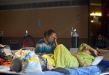 The Shehnai banquet hall is a covid facility that was opened last year. The facility is currently overburdened unlike last year. This facility did not have oxygen cylinders, but it does have now, as most of the patients complaint of breathing difficulties | Suraj Singh Bisht | ThePrint