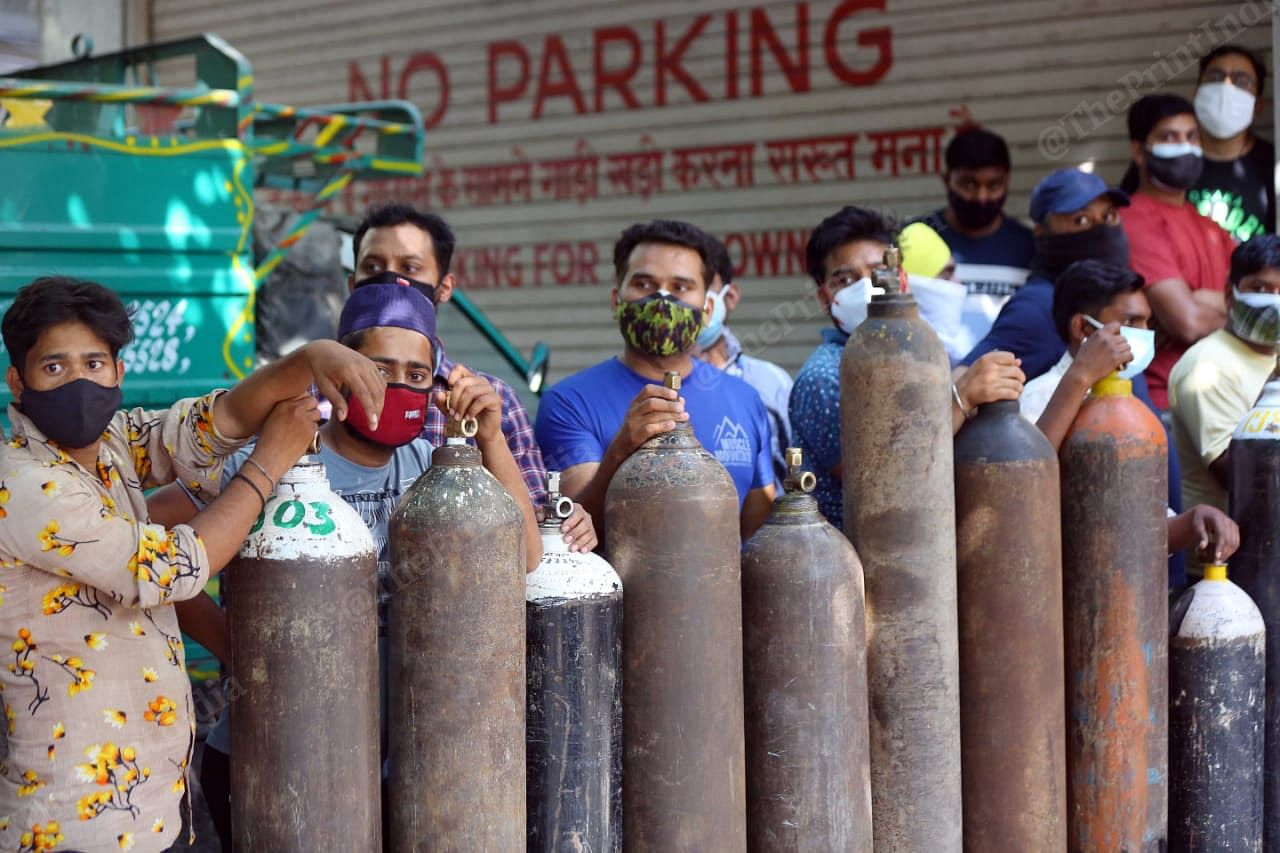People stood in queues since morning to get oxygen cylinder filled for their family members. This shop is Bhogal witnesses huge rush, and the crowd still continues   Suraj Singh Bisht   ThePrint