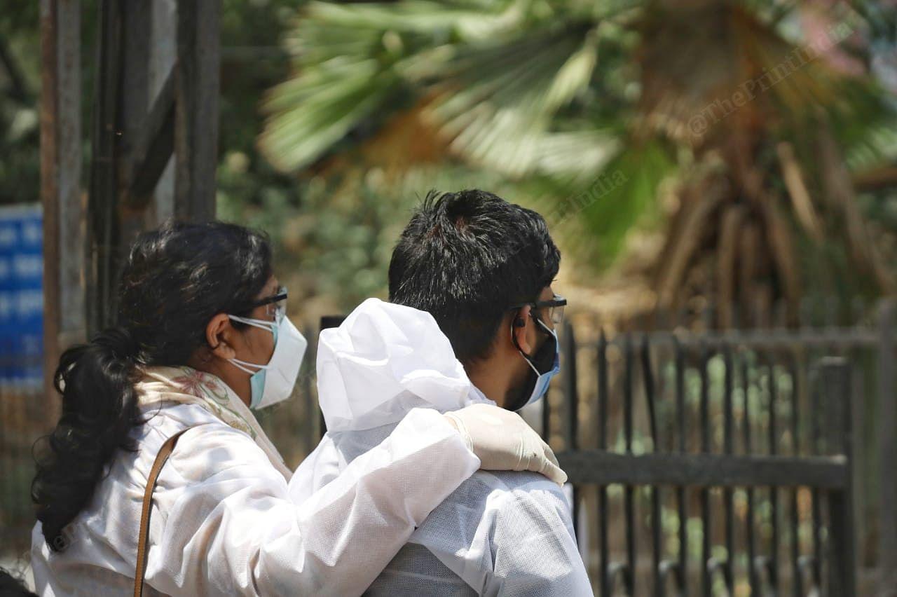 Relatives wait outside holding each other | Manisha Mondal | ThePrint