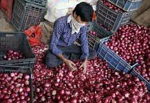 Representational image of an onion seller at Delhi's Azadpur Mandi | File photo: ANI