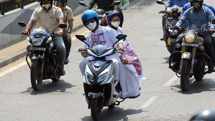 West Bengal CM Mamata Banerjee is driven from her residence to Nabanna by state minister Firhad Hakim on an electric scooter as a mark of protest against rising fuel prices, in February 2021   ANI
