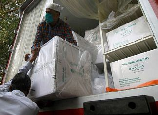 Workers unloading boxes of Bharat Biotech's Covaxin in Uttar Pradesh's capital Lucknow Sunday | Photo: ANI