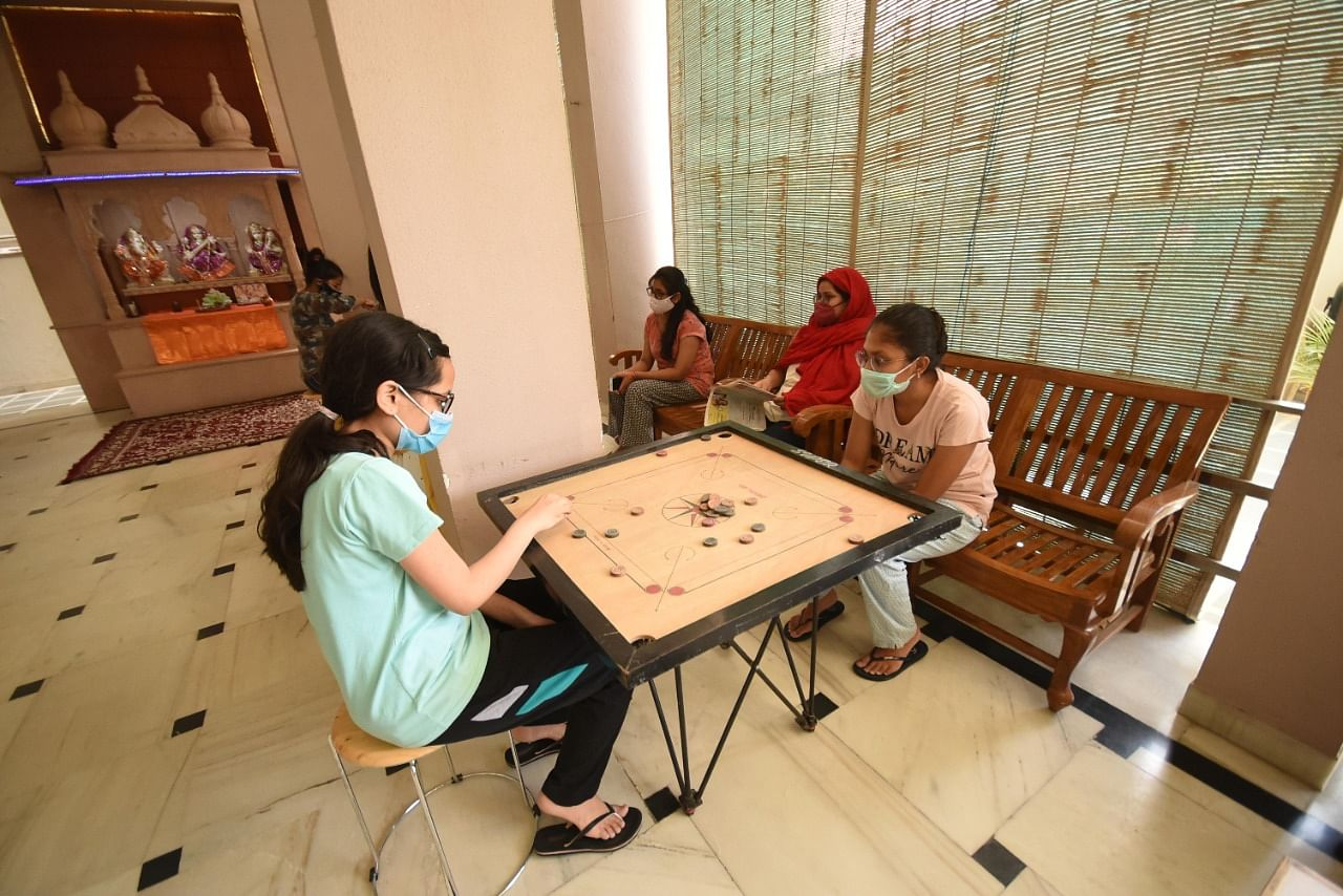 Students at a girls' hostel in Kota who continue to stay put even as most of their fellow classmates have left for their hometowns amid the surge in cases in the district. The girls are seen playing a game of carrom during their break time. | Photo: Rohit Jain Paras/ThePrint