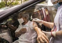 A person receives a dose of Covid-19 vaccine at a drive-thru vaccination site set up at the DLF Mall of India in Noida, UP   Photographer: Anindito Mukherjee   Bloomberg