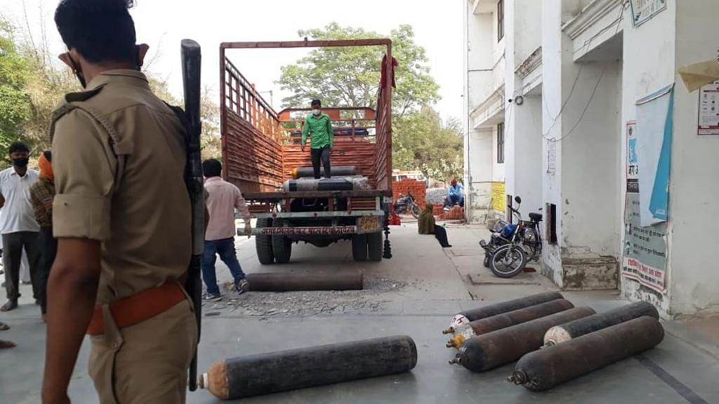 Oxygen cylinders being unloaded from a truck at the Dasratha Medical College in police presence Saturday | Photo: Moushumi Das Gupta | ThePrint
