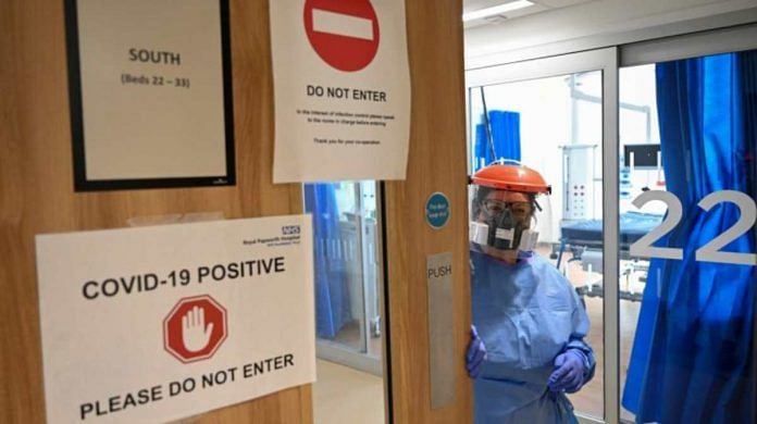 Representational image   A medical worker in PPE suit holds the door to a Covid-19 positive area, in the ICU at a hospital in Cambridge   Photo: Neil Hall   EPA via Bloomberg