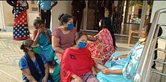 Grieving relatives outside the district hospital at Chamarajanagar | Rohini Swamy | ThePrint