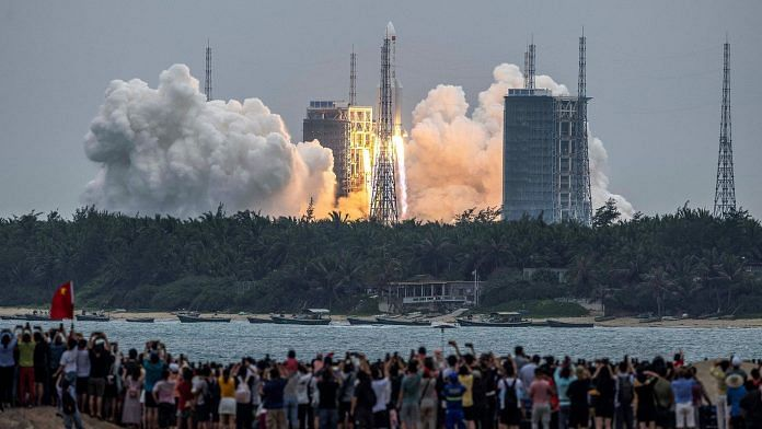 Long March 5B rocket, carrying China's Tiangong-3 space station core module, at the Wenchang Space Launch Center in southern China's Hainan province, on 29 April 2021 | Photo: STR/AFP/Getty Images via Bloomberg  - China 696x392 1 - Moon & Mars done, Jupiter & Uranus next on the list — China's racing away in space too