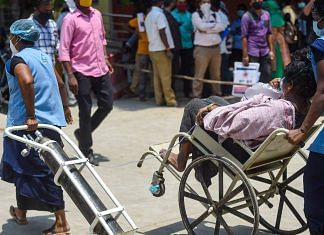 A patient being taken for CT scan with oxygen support at Government Kilpauk Medical College (GKMC) Hospital, in Chennai in April 2021   PTI