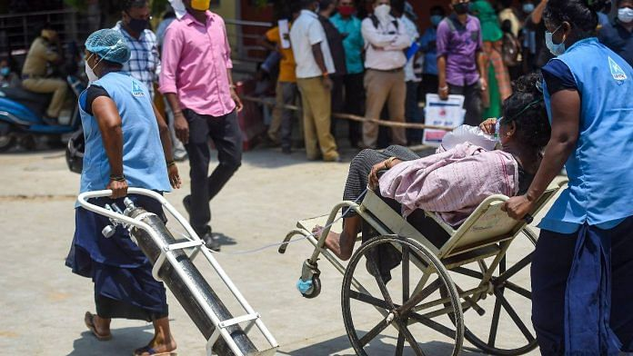 A patient being taken for CT scan with oxygen support at Government Kilpauk Medical College (GKMC) Hospital, in Chennai in April 2021 | PTI