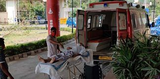 A person suffering from Covid is shifted to the isolation facility at the Rajiv Gandhi Cricket stadium in Dehradun | Taran Deol | ThePrint
