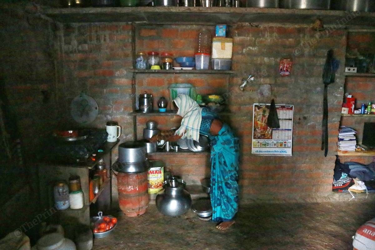 Shiva's mother works in one corner of their home that functions as the kitchen | Manisha Mondal | ThePrint