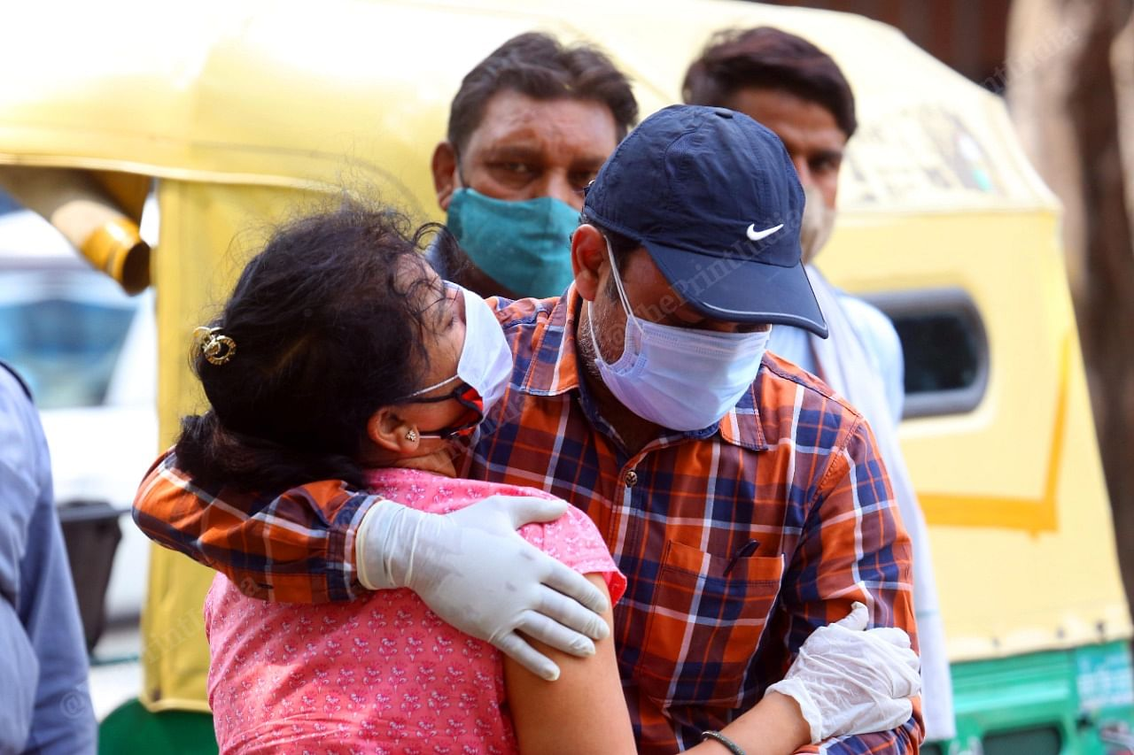 Outside LNJP hospital, family members grieve over the death of a relative   Praveen Jain   ThePrint