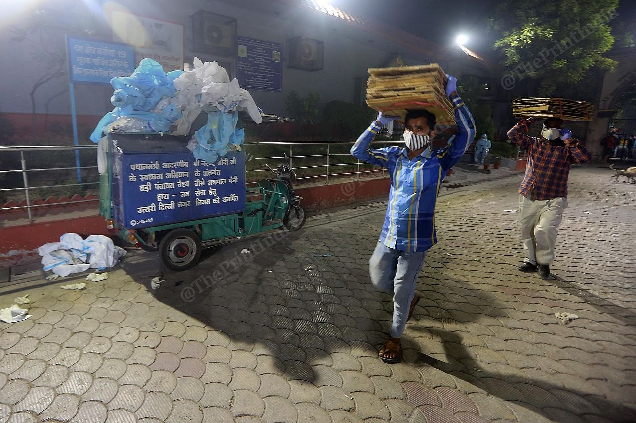 A dumpster full of PPE kits lies at the entrance of the Nigambodh Ghat crematorium   Praveen Jain   ThePrint