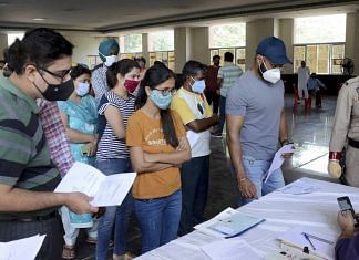 Representational image| People stand in queues to register themselves for COVID-19 vaccine dose, in Amritsar | PTI