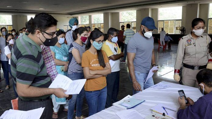 Representational image  People stand in queues to register themselves for COVID-19 vaccine dose, in Amritsar   PTI