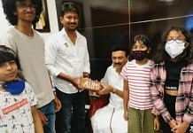 Udhayanidhi Stalin with his father, DMK chief M.K. Stalin, and that AIIMS brick | Twitter/@Udhaystalin