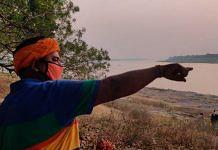 Ramashray Singh, deputy sarpanch of Chausa in Buxar district of Bihar, points to Mahadev Ghat where 71 dead bodies floating down the Ganga were buried | Photo: Sajid Ali | ThePrint
