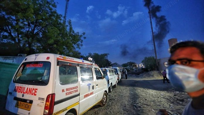 Ambulances queue up outside outside the Juna vadaj crematorium as chimneys bellow smoke   Photo: Praveen Jain   ThePrint