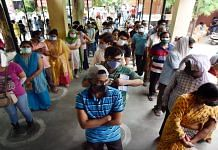 Beneficiaries wait for queues to receive Covid vaccine doses at Tej Bahadur Sapru Hospital in Prayagraj, UP, on 17 May 2021 | PTI
