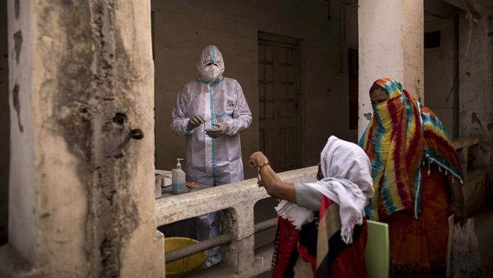 A health worker prepares for a swab sample to be taken at a Covid-19 testing site in Agra, Uttar Pradesh, on 3 May 2021 | Photographer: Anindito Mukherjee | Bloomberg