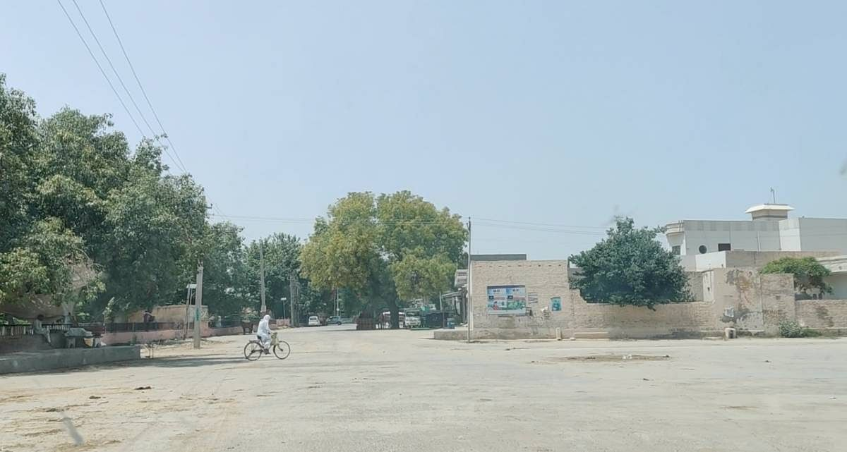 An empty stretch of village road as residents stayed indoors because of the Covid scare in the village | Reeti Agarwal | ThePrint