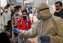 A health worker conducts rapid antigen tests in Delhi | Representational image | PTI