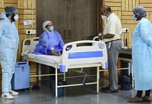 A doctor and health workers attend a Covid-19 patient at a care centre in Dwarka, New Delhi, on 10 May 2021 | PTI