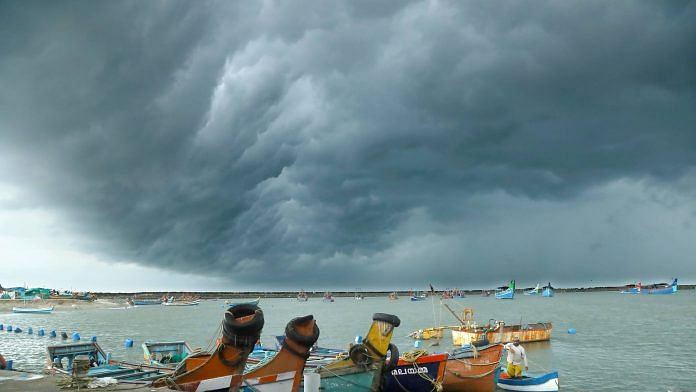 Clouds gather ahead of the landfall of Cyclone Tauktae at Vellayil Harbor in Kozhikode