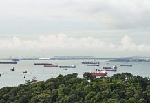 Container ships and bulk carriers offshore from Singapore | Bloomberg