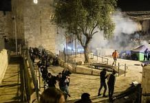 Palestinians clash with Israeli police officers at Damascus Gate in Jerusalem, on 8 May 2021 | Bloomberg