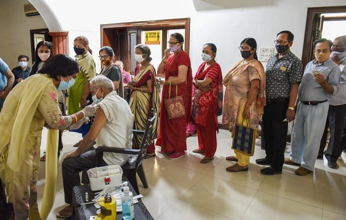 Representational image | File photo of people in a queue for Covid vaccines in Gurugram | PTI
