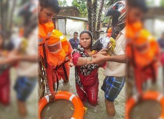 NDRF team carries out a rescue operation after lanfall of cyclone Yaas at South 24 parganas in West Bengal, on 26 May 2021   PTI